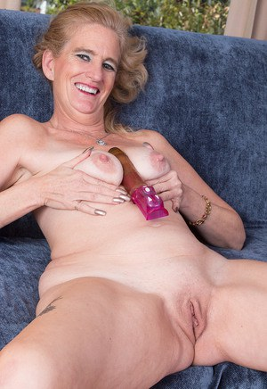 Stuffing her ass and pussy with lots of dildos and balls 8
