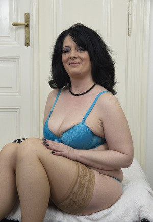 A horny granny being flirtatious and strips 9